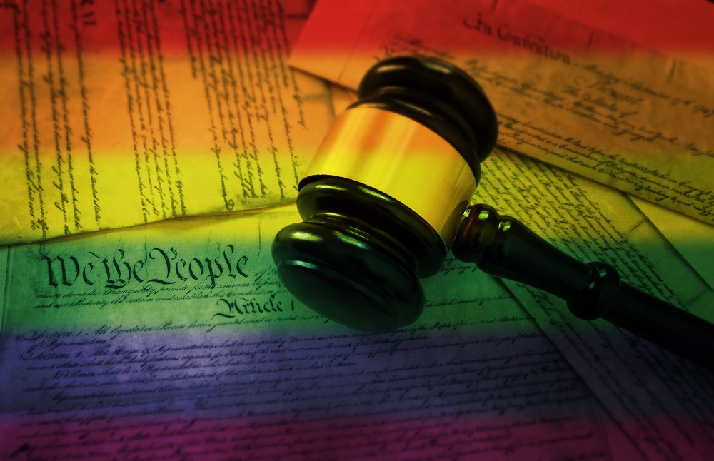 Gavel with rainbow and justice documents