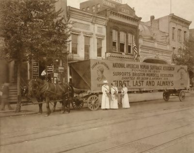 In 1914 a horse drawn float declares National American Woman Suffrage Association's support for Bristow-Mondell Resolution drafted by Susan B. Anthony in 1874.