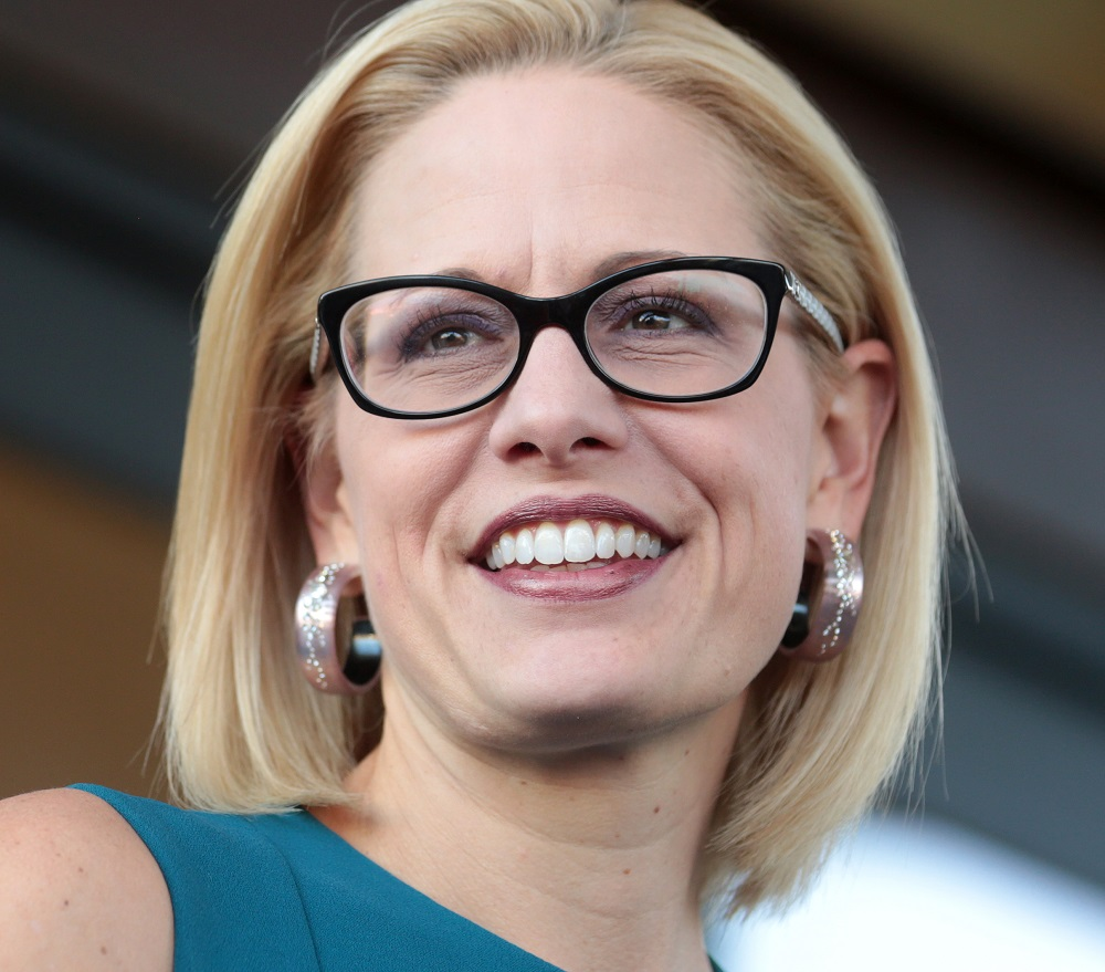 Beltway media outlet makes bizarre statement about Kyrsten Sinema's bisexuality & gets called out