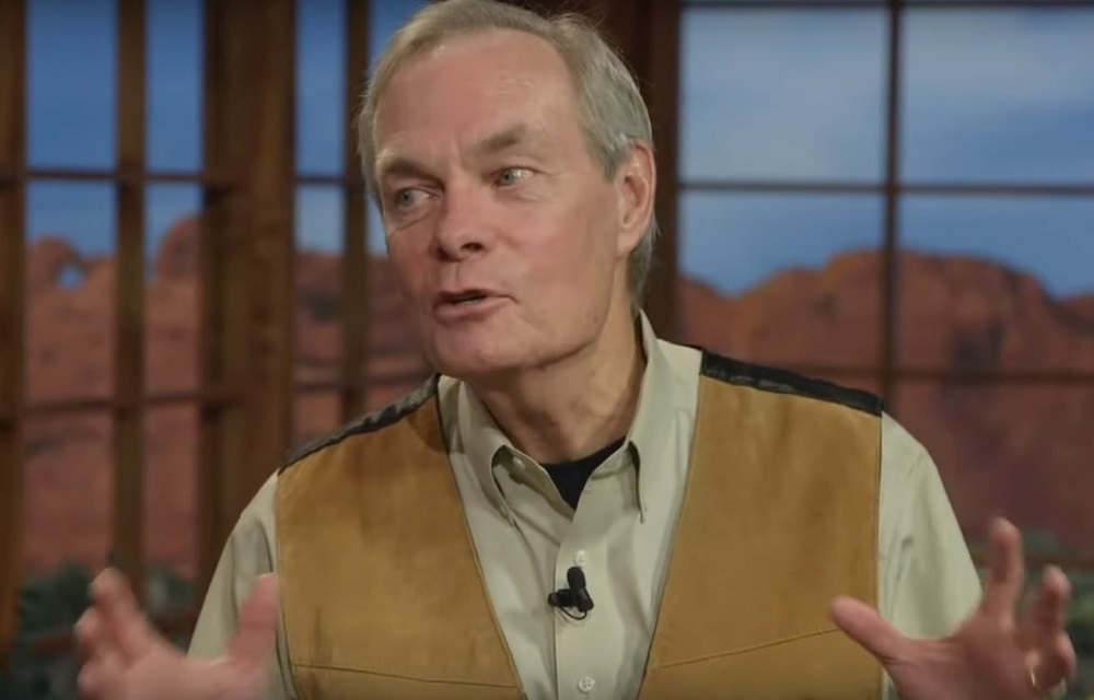 Andrew Wommack waving his hands