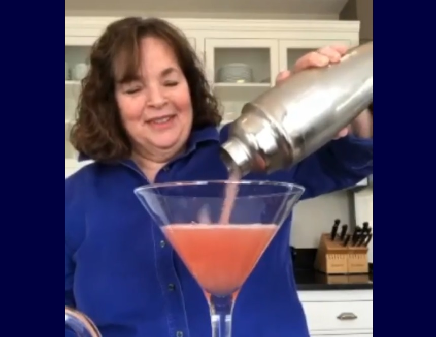Ina Garten pouring her cosmo into an enormous martini glass