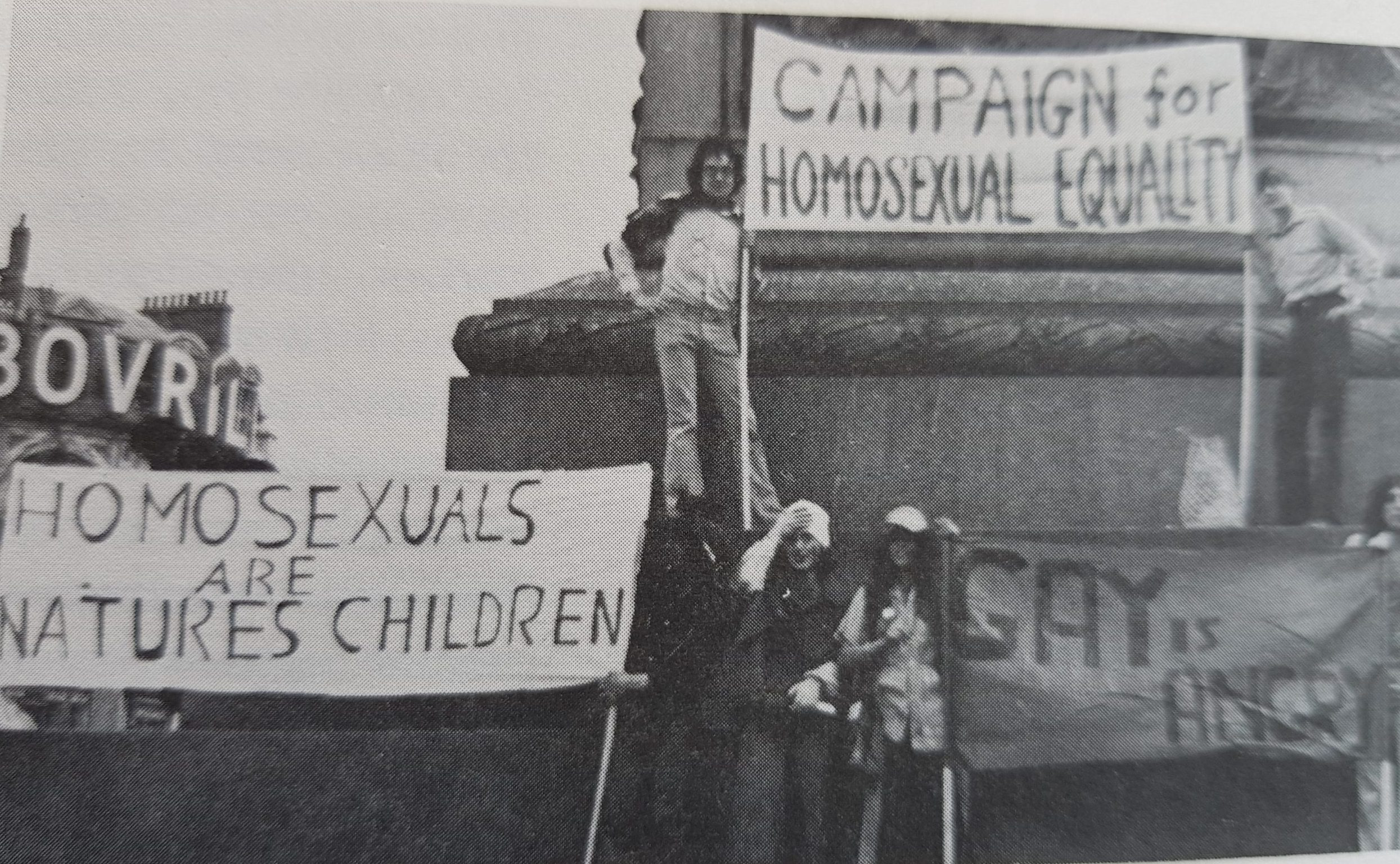 David Pollak holding a sign at an early Pride event in the United Kingdom, summer 1972.