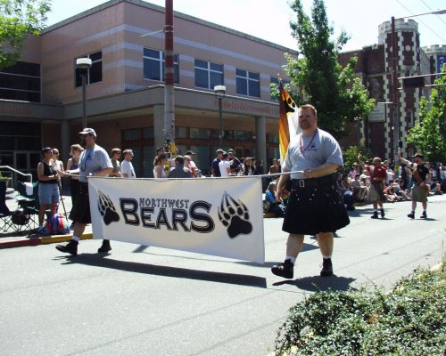 Paul Quesnell holding the Northwest Bears banner while marching in the Seattle Pride Parade, June 28 2004.