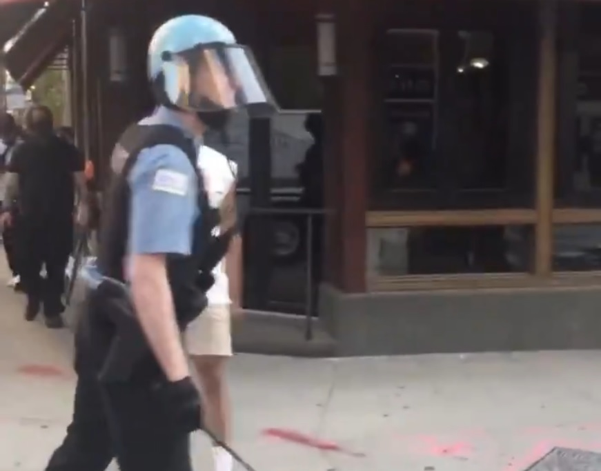 The police officer in protective gear
