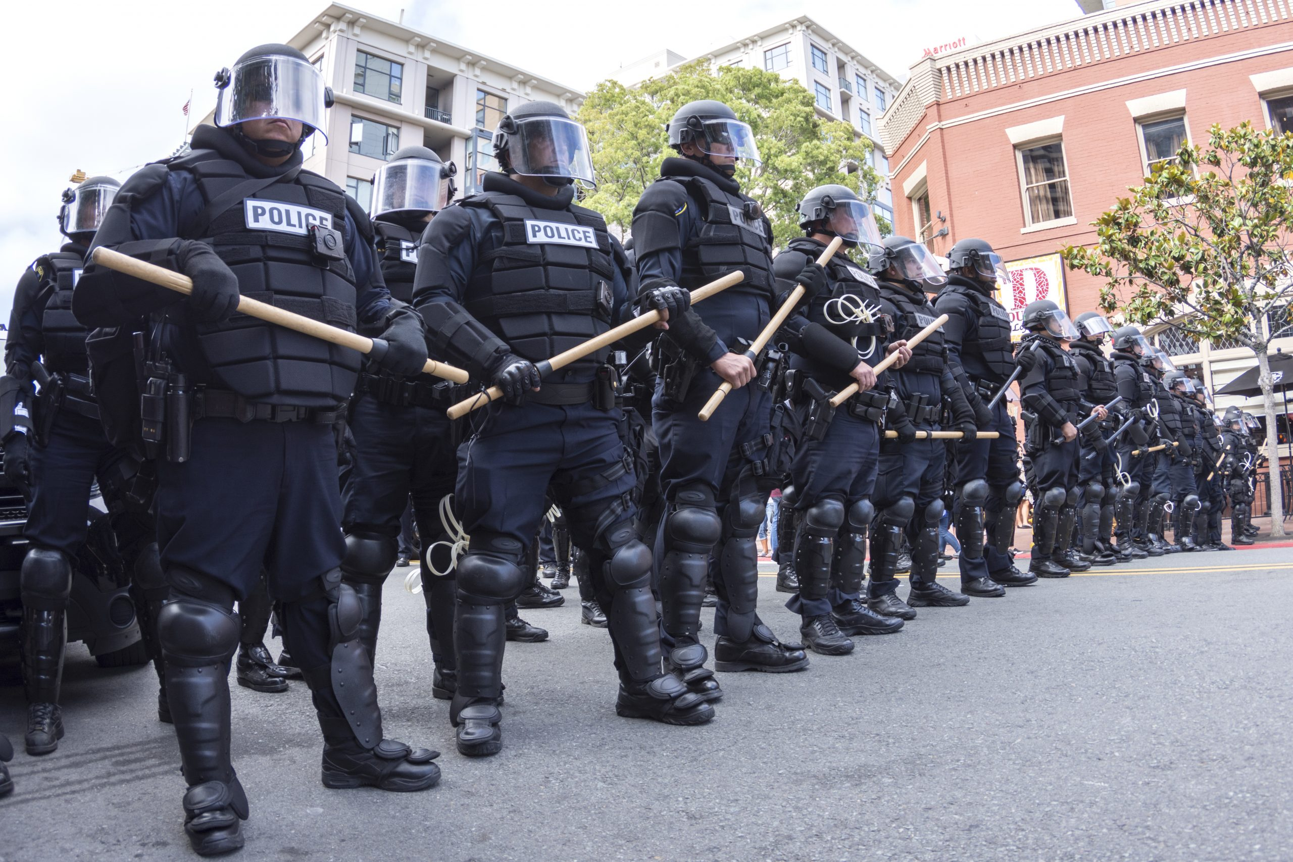 MAY 27, 2016: Riot police in full tactical gear stand ready to confront protesters at a Trump rally at the San Diego Convention Center