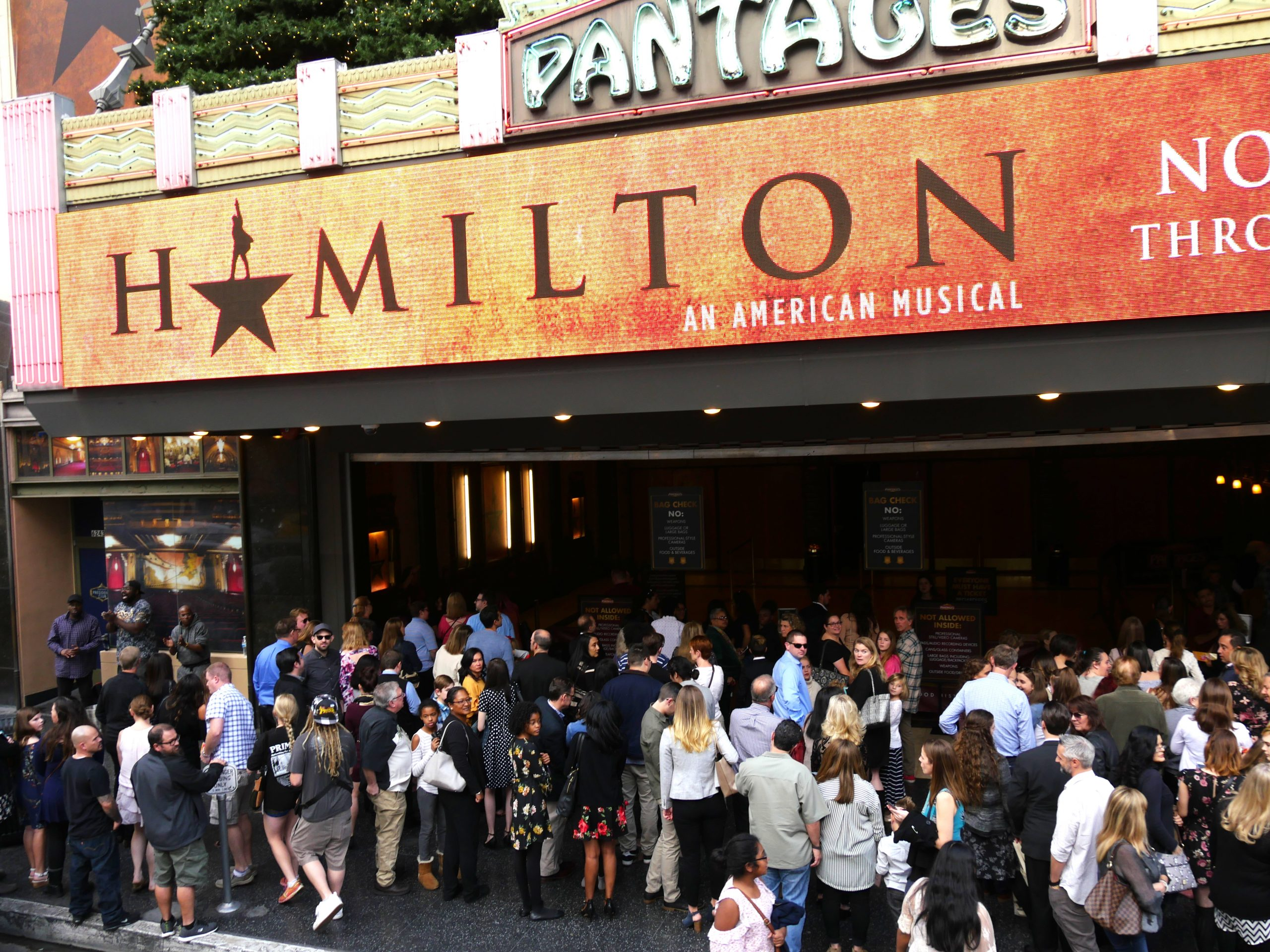 "JANUARY 2018: Crowds of people wait outside the Pantages Theatre in Hollywood, CA for the musical ""Hamilton"""