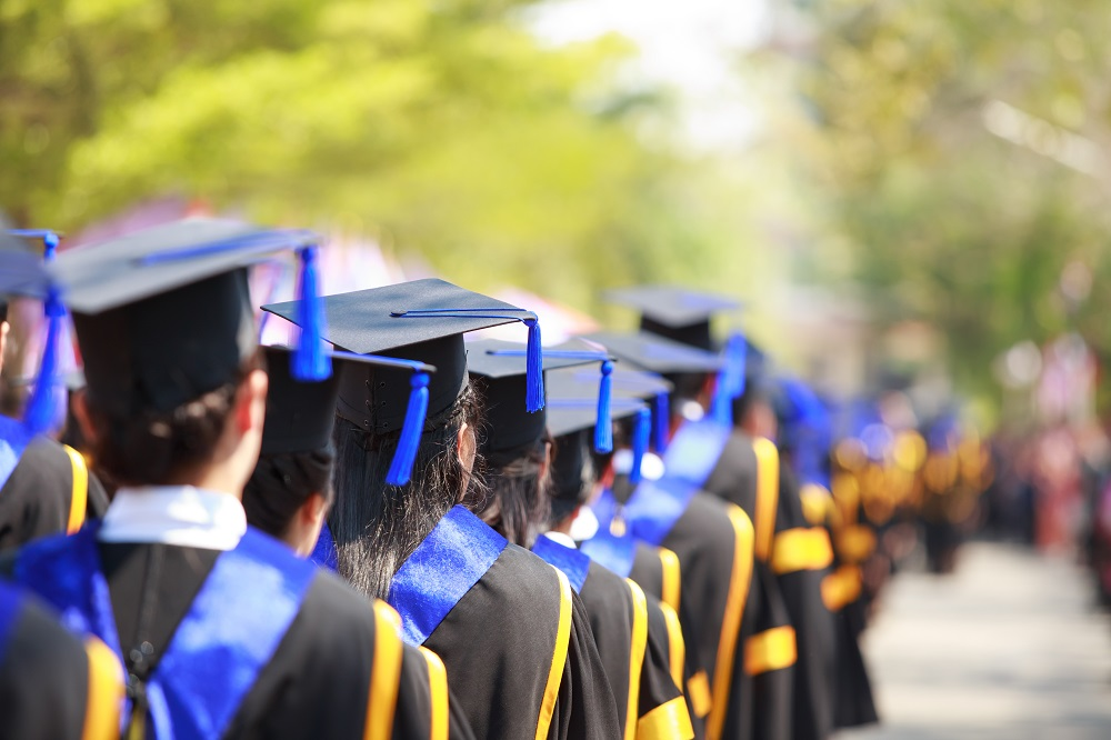 High school graduates with mortarboards
