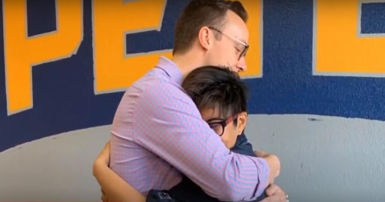 Chasten hugging a boy