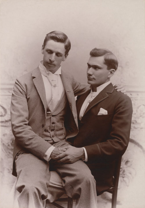 Two men pose in the 1870s