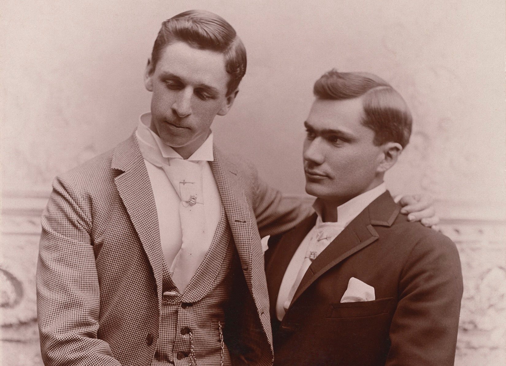Two men pose in the late 1800s
