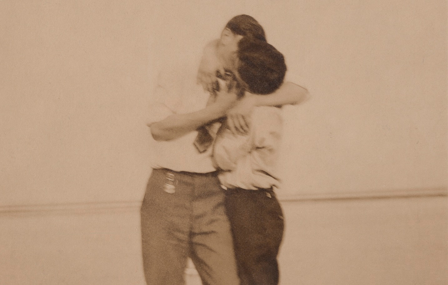 Two men kiss on Labor Day 1910