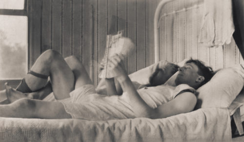 A rare photo of two men in bed together as a couple.
