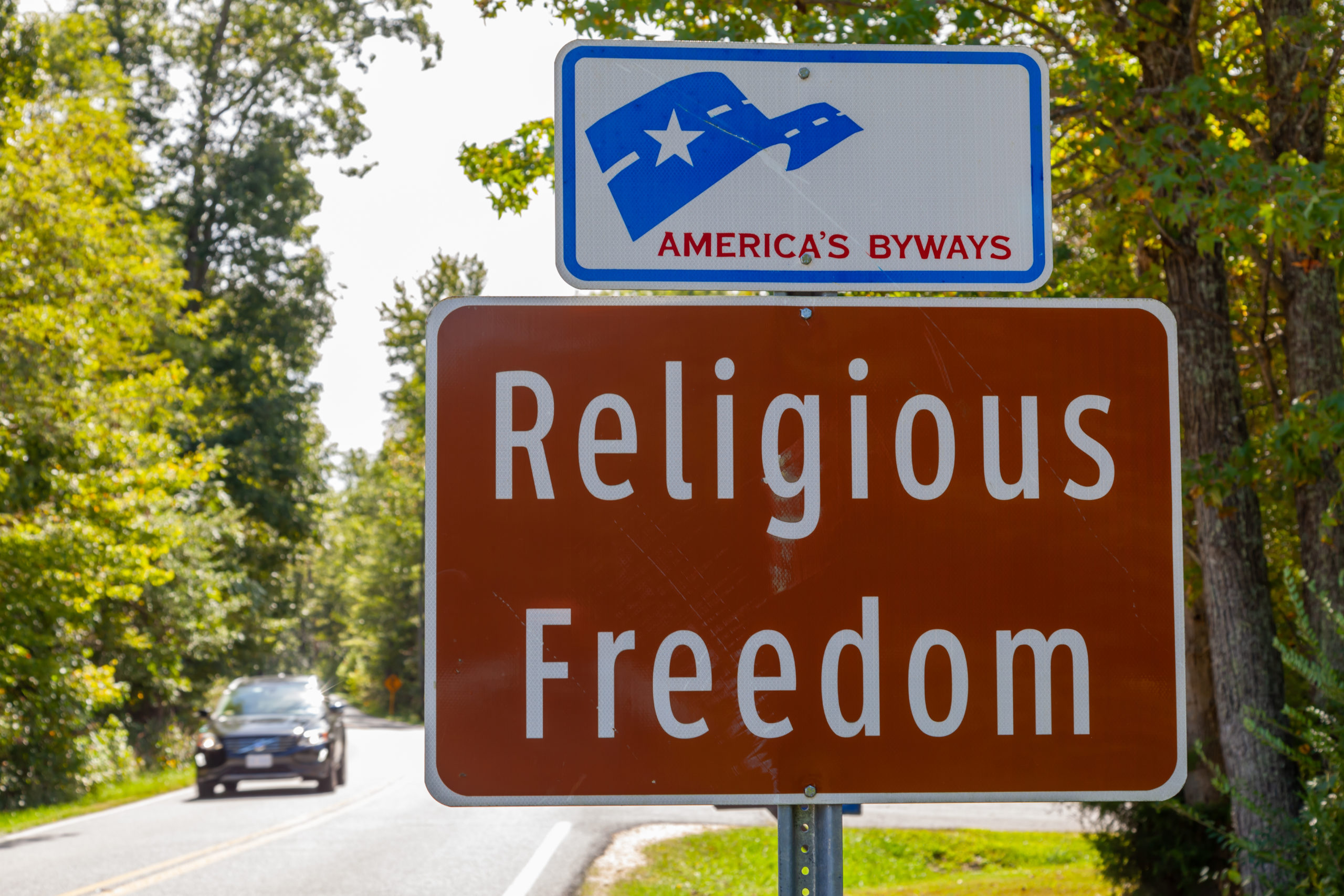 "Waldorf, MD, USA 09/19/2020: road sign at the entry of one of Maryland's scenic byways named ""Religious Freedom"" in reference to Southern Maryland being the cradle of religious liberty in the USA."