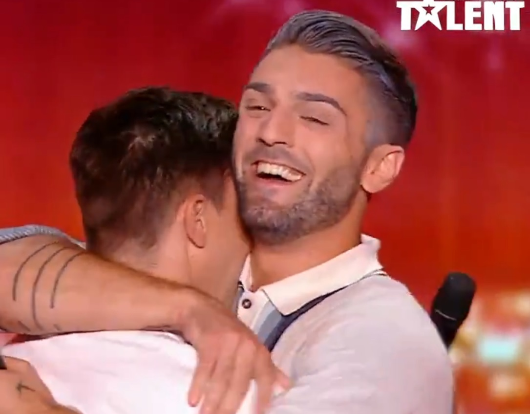 Alex and Alex hug after their performance