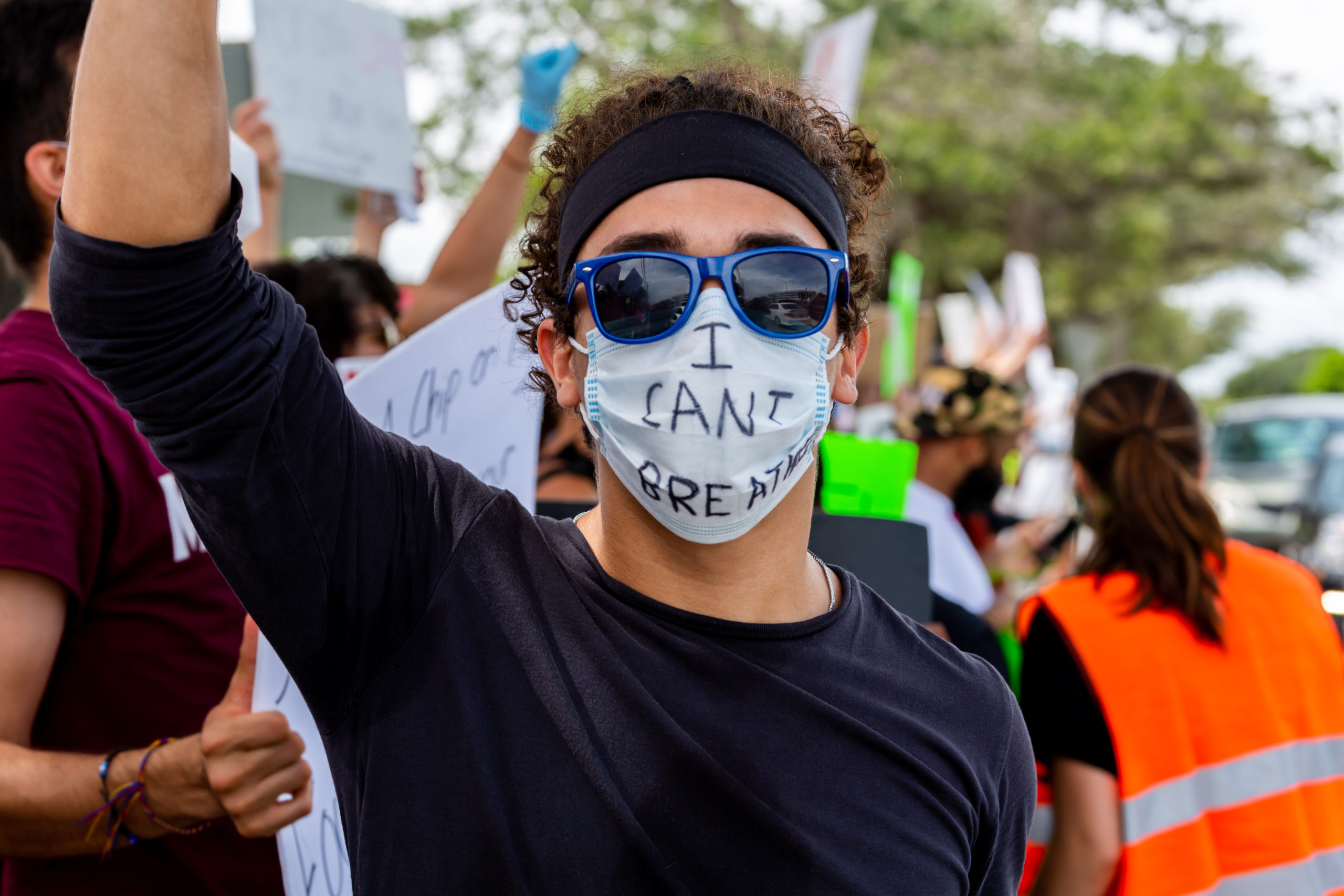 """A man wearing sunglasses and a mask with the phrase """"I Can't Breathe"""" in protest against the death in Minneapolis police custody of African-American man George Floyd at Coral Springs, Florida."""