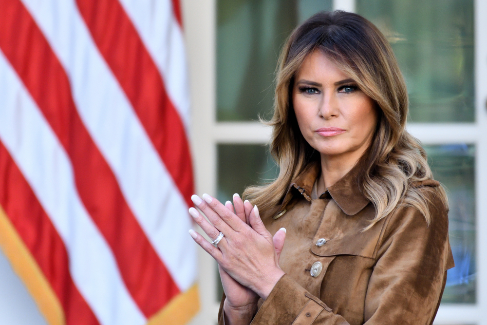 """WASHINGTON, DC - NOVEMBER 26, 2019: First Lady Melania Trump stands in the Rose Garden of the White House as the President pardons the Thanksgiving Turkey, """"Butter""""."""