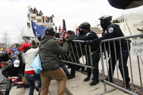 Supporters of U.S. President Donald Trump clash with police officers outside of the U.S. Capitol Building in Washington, U.S., January 6, 2021.