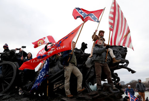 Pro-Trump protesters wave banners during clashes with Capitol police during the certification of the 2020 U.S. presidential election results by the U.S. Congress, Washington, D.C., U.S., Jan. 6, 2021