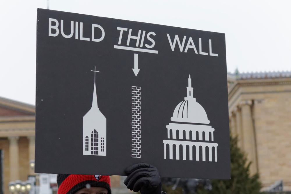 January 18, 2020: A sign mocking Donald Trump's border wall and supporting separation of church and state is seen at the fourth annual Women's March on Philadelphia
