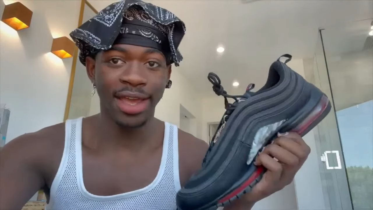 """Lil Nas X calls out the """"crying nerds on the internet"""" who got his Satan shoes canceled"""