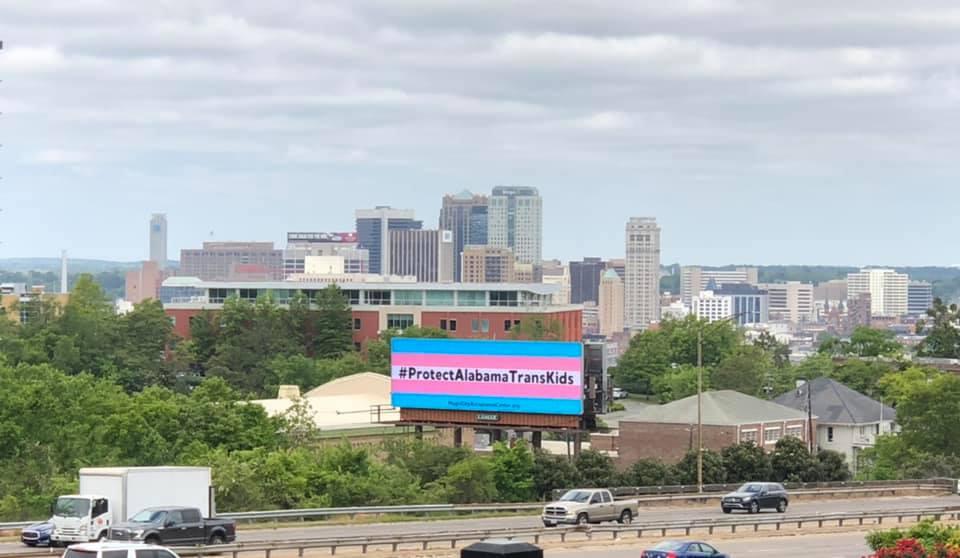 A massive trans flag billboard is giving kids hope & putting pressure on Alabama Republicans