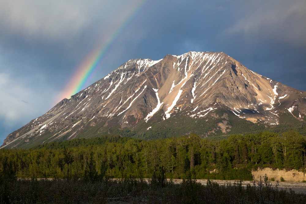 a rainbow and a mountain in alaska