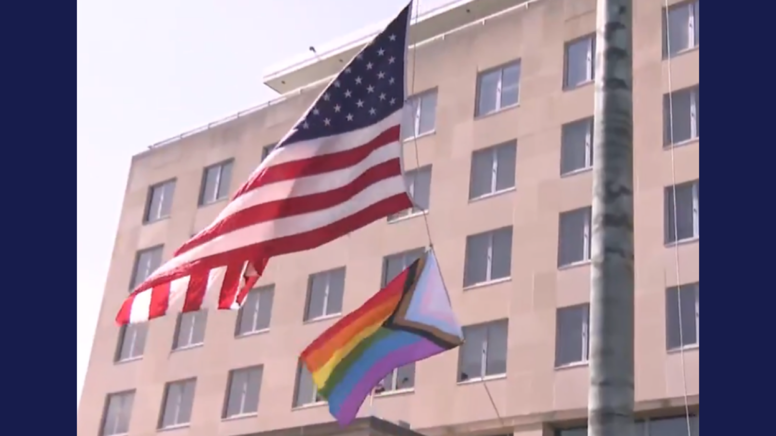 The State Department raises the Progress Pride flag over their headquarters