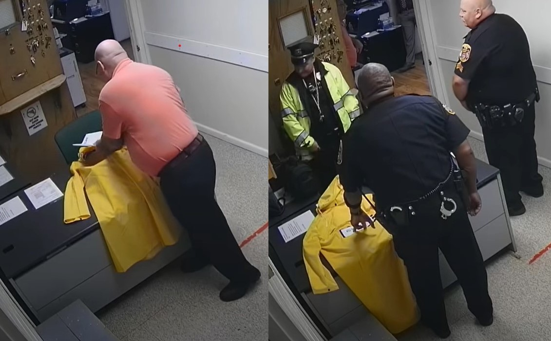 Police chief busted on camera putting a KKK sign on a Black officer's desk
