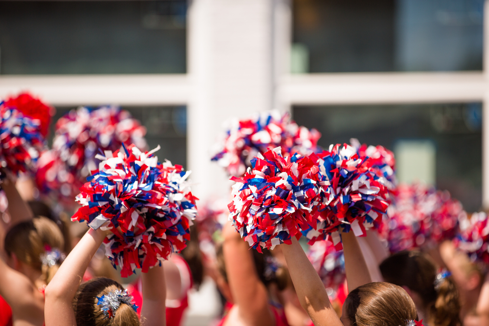 Students rally for cheer coach who says he was fired because he's gay