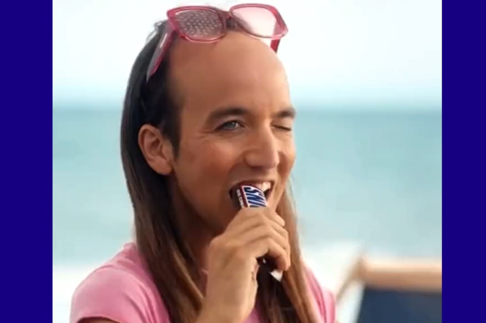 Snickers implies their candy bar will turn you straight in wildly homophobic ad