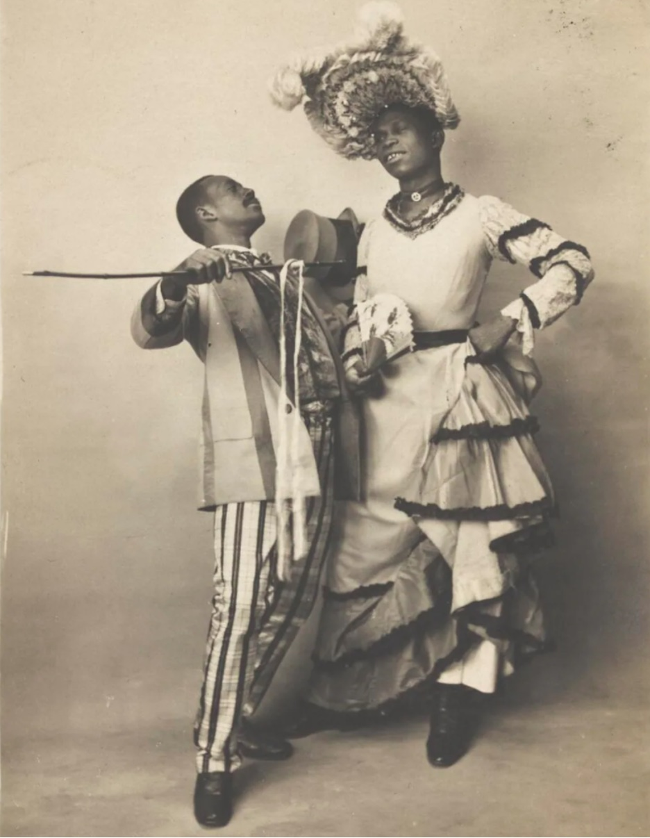 A Black drag queen and a male performer, circa 1903.