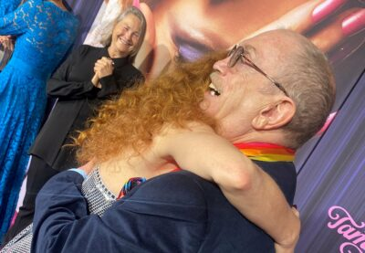 Jessica Chastain embraces Rev. Steve Pieters on the red carpet
