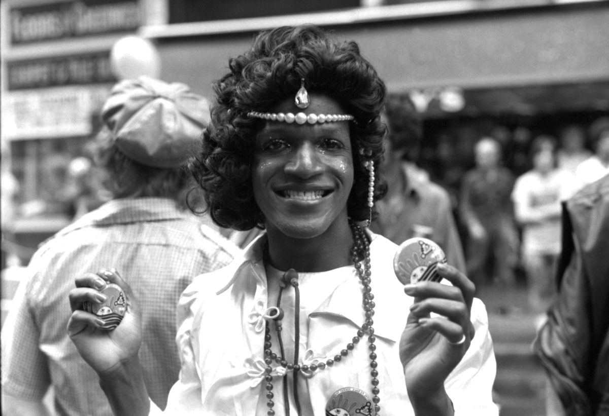 American gay liberation activist Marsha P Johnson (1945 - 1992) (left) during the Pride March (later the LGBT Pride March), New York, 1975